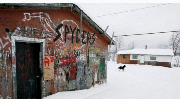 An abandoned house on the Pikangikum First Nation, in northwestern Ontario, in a 2007 file photo. Nine people are feared to have died in a house fire.
