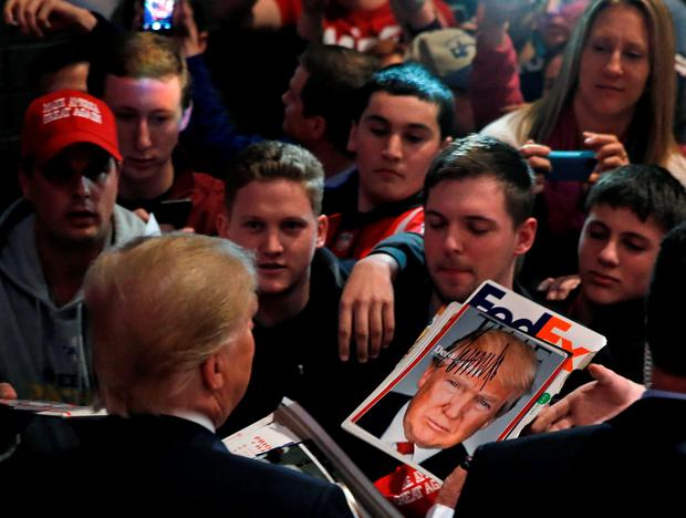 U.S. Republican presidential candidate Donald Trump greets supporters at a campaign rally in De Pere, Wisconsin, United States, March 30, 2016