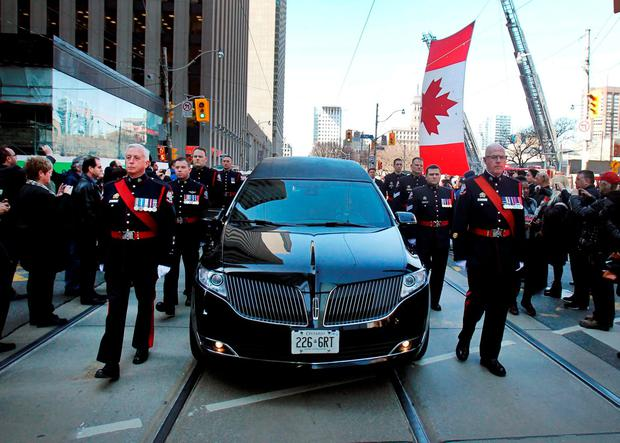 Procession with the casket carrying former mayor Rob Ford makes its way to St James Cathedral for funeral services in Toronto, March 30, 2016
