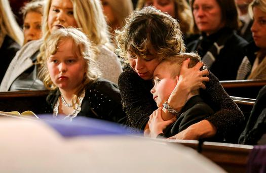 Widow Renata comforts her son Dougie, and daughter Stephanie at the funeral for former Toronto mayor Rob Ford, who died last week of cancer, at St. James Cathedral in Toronto, Canada, March 30, 2016