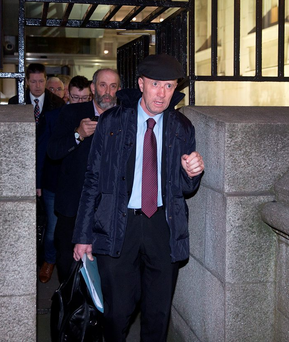 Danny and Michael Healy-Rae leaving Government Buildings after talks with Fine Gael. Photo: Arthur Carron