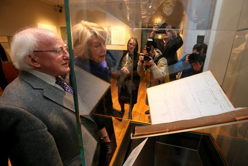 President Michael D Higgins and his wife Sabina view the courts offical book at the official opening of the new Kilmainham Gaol Museum visitor centre. Photo: Damien Eagers