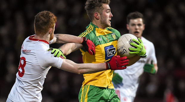 Stephen McMenamin in action against Cathal McShane (SPORTSFILE)