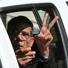 EgyptAir plane hijacking suspect Seif al-Din Mustafa flashes the victory sign as he leaves court in a police car in the Cypriot coastal town of Larnaca yesterday. Photo: Petros Karadjias/AP Photo
