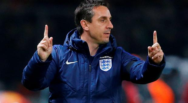 Gary Neville will now concentrate on his role with England after being sacked by Valencia (Reuters)