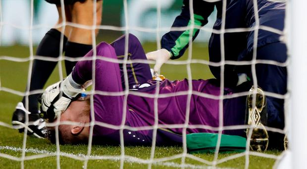 Republic of Ireland's Rob Elliot receives treatment after sustaining an injury before being substituted (Reuters)