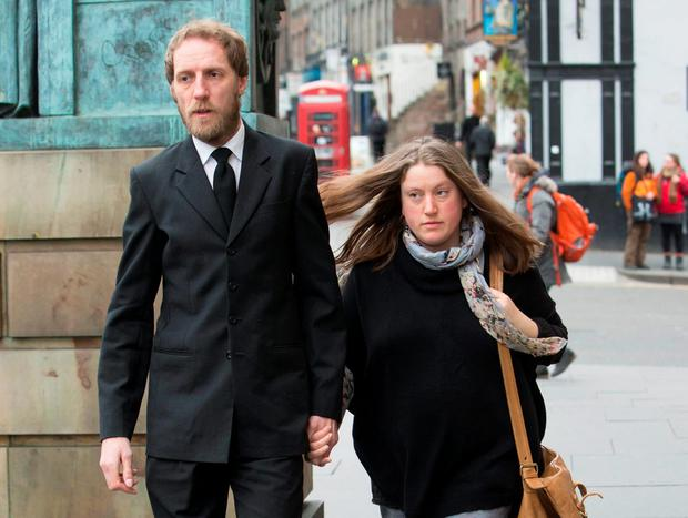 Kate Gwynne, whose son, Bailey Gwynne, died from a knife wound to the chest in a fight at Cults Academy in Aberdeen, arrives with his stepfather, John Henderson, at the High Court in Edinburgh. Danny Lawson/PA Wire