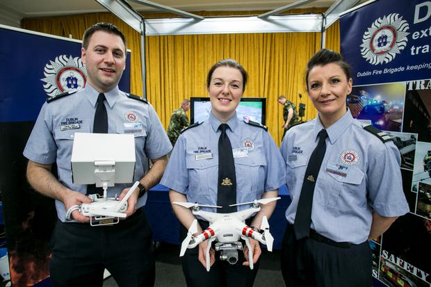 Dublin Fire Brigade's Ciaran Lalor with Teresa Hudson and Caroline Gunning pictured at the Drone Expo Show in the RDS.