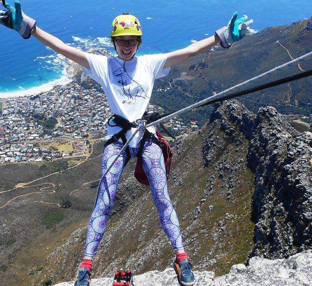 Aoife Breen preparing to abseil off Table Mountain, Cape Town, South Africa. Photo Credit: Aoife Breen
