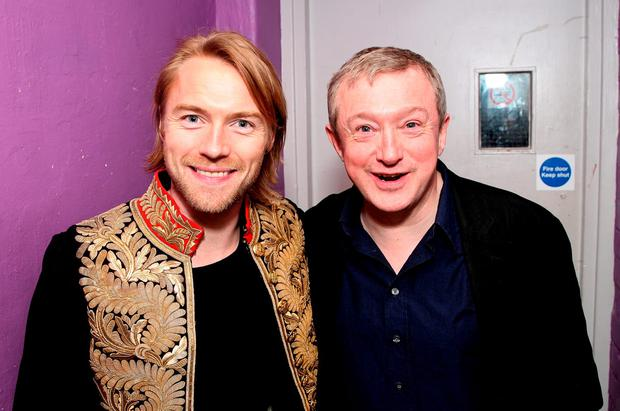 Ronan Keating (L) and Louis Walsh pose backstage prior to the band's pre-tour gig, their first show together in 8 years, at G.A.Y. on March 1, 2008
