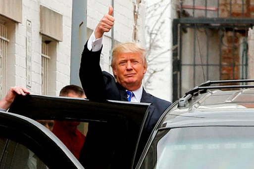 US Republican presidential candidate Donald Trump waves to onlookers and reporters as he departs through a back door after meetings at Republican National Committee (RNC) headquarters in Washington. Reuters/Jonathan Ernst