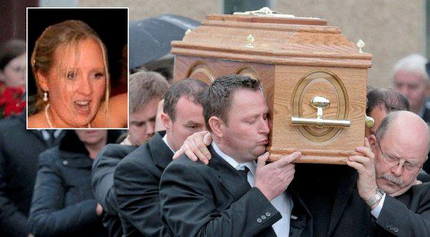 Bernard Fitzpatrick kisses his wife Tracy's Coffin after her funeral mass at St. Ann's Church, Shanvaghera, Knock, Co. Mayo