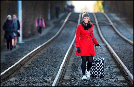 Alana Butler walking from Dundrum to Dublin city centre along the Luas tracks at Ranelagh during the strike in February. Photo: Steve Humphreys