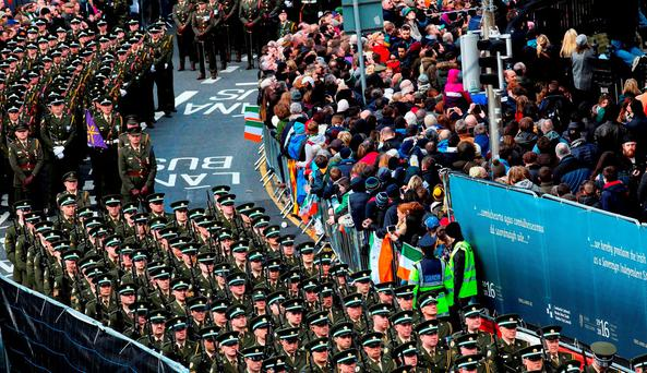 Defence Force members parade during the 1916 centenary celebrations. Photo: Maxwells/PA Wire