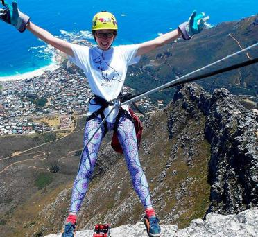 Aoife Breen preparing to abseil off Table Mountain in Cape Town, South Africa.