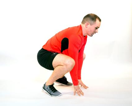 (a) John from No 17 Personal Training does a Burpee. Photo: Tony Gavin