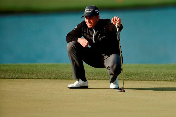 Henrik Stenson of Sweden lines up a putt on the 12th green at the Houston Open (Stacy Revere/Getty Images)