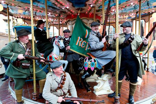 Participants in the RTÉ Reflecting the Rising event take a break on the merry-go-round in Smithfield on Easter Monday. The 1916 commemorations in Dublin last weekend had a sense of democratic inclusion, and celebrated forgotten figures – from revolutionary women to the children who were killed in the Rising. Photo: Maxwells