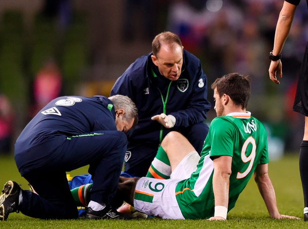 Shane Long receives treatment during the match against Slovakia.