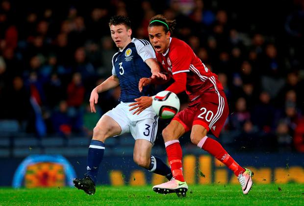 Scotland's Kieran Tierney vies with Yussuf Yurary Poulsen of Denmark during the International Friendly at Hampden Park