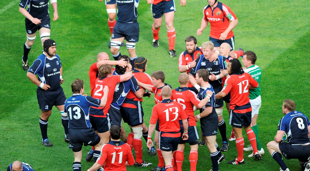 Alan Quinlan, Munster, is restrained by Shane Horgan, Leinster, who in turn is restrained by Paul O'Connell and Jerry Flannery, 2, as Quinlan confronts Leo Cullen