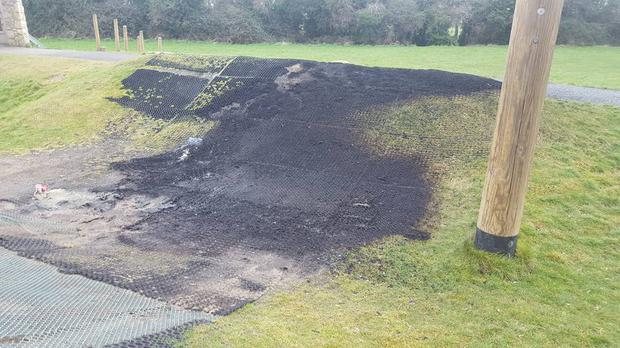 The charred remains of rubber matting in a play space in Hermitage Green, Lucan. Photo: William Lavelle