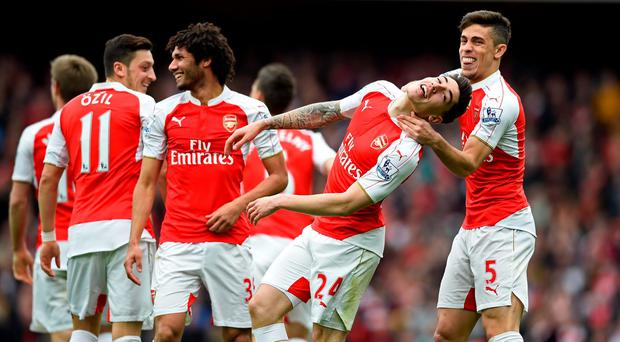 Hector Bellerin celebrates scoring the third goal for Arsenal