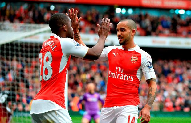 Arsenal's Theo Walcott (right) celebrates with team-mate Joel Campbell