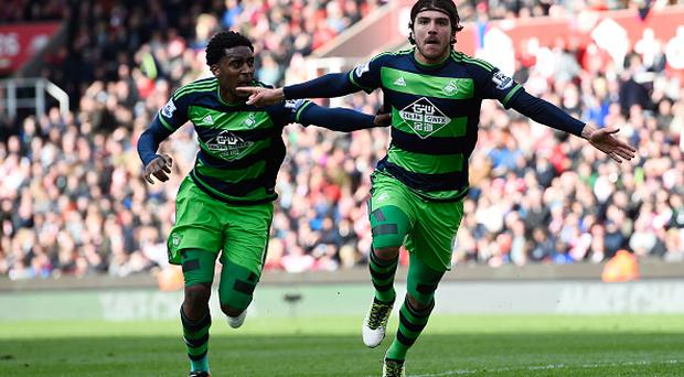 STOKE ON TRENT, ENGLAND - APRIL 02: Alberto Paloschi (R) of Swansea City celebrates scoring his team's second goal with his team mate Leroy Fer (L) during the Barclays Premier League match between Stoke City and Swansea City at Britannia Stadium on April 2, 2016 in Stoke on Trent, England. (Photo by Stu Forster/Getty Images)
