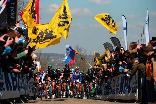 Luke Rowe (C) of Great Britain and Team Sky leads the peloton up the Oude Kwaremont during the 2015 Tour of Flanders from Bruges to Oudenaarde on April 5, 2015 in Oudenaarde, Belgium. (Photo by Bryn Lennon/Getty Images)