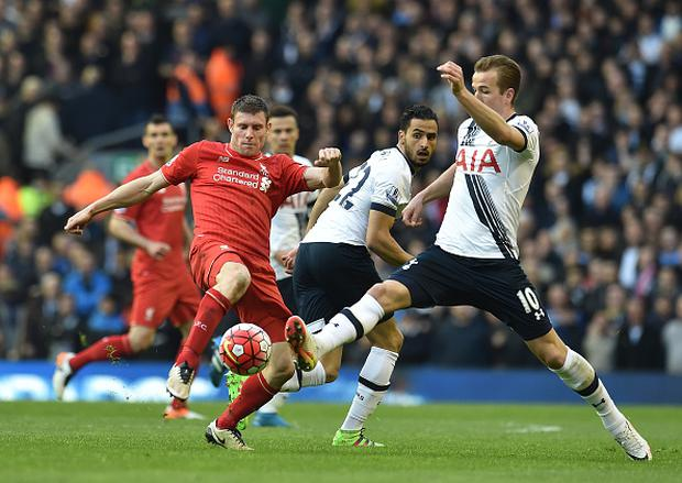 LIVERPOOL, ENGLAND - APRIL 02: (THE SUN OUT, THE SUN ON SUNDAY OUT) James Milner of Liverpool competes with Harry Kane of Tottenham Hotspur during the Barclays Premier League match between Liverpool and Tottenham Hotspur at Anfield on April 2, 2016 in Liverpool, England. (Photo by Andrew Powell/Liverpool FC via Getty Images)