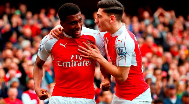 Alex Iwobi celebrates scoring Arsenal's second goal with Hector Bellerin at Emirates Stadium yesterday. Photo: Julian Finney