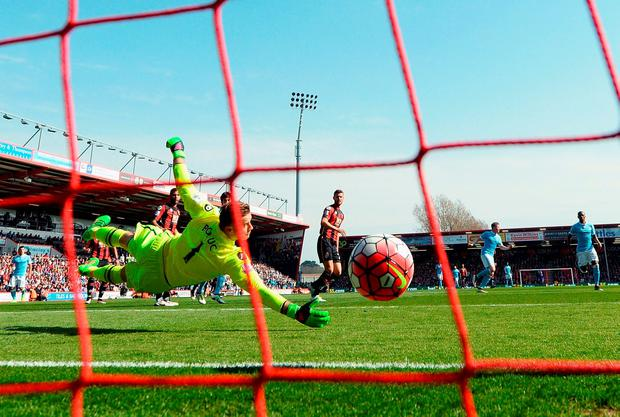 Artur Boruc of Bournemouth dives in vain as Kevin de Bruyne of Manchester City scores his team's second goal. Photo: Getty