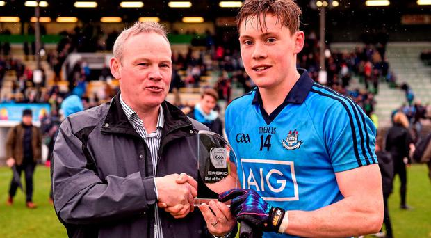 Dublin's Con O'Callaghan is presented with the EirGrid Man of the Match award by John Fitzgerald from EirGrid Picture credit: Paul Mohan / Sportsfile