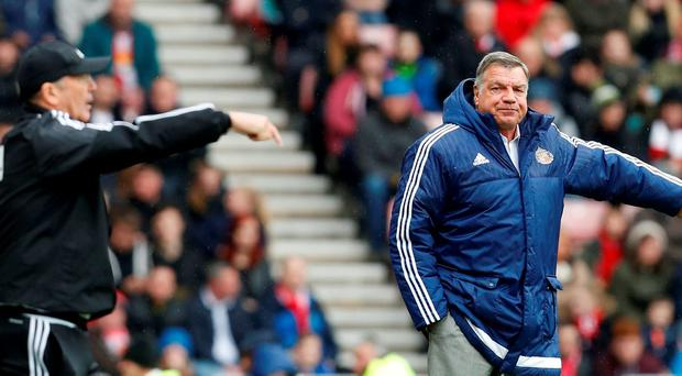 West Brom manager Tony Pulis and Sunderland manager Sam Allardyce look on. Photo: Reuters / Ed Sykes