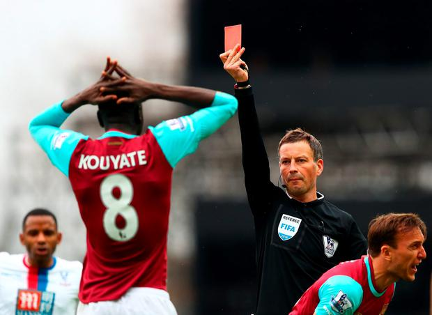 Cheikhou Kouyate of West Ham United is shown a controversial red card by referee Mark Clattenburg. Photo: Getty