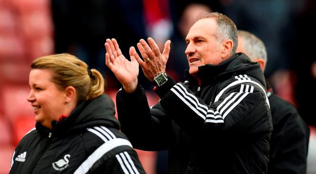 Francesco Guidolin, Manager of Swansea City applauds the away supporters after the match. Photo: Getty