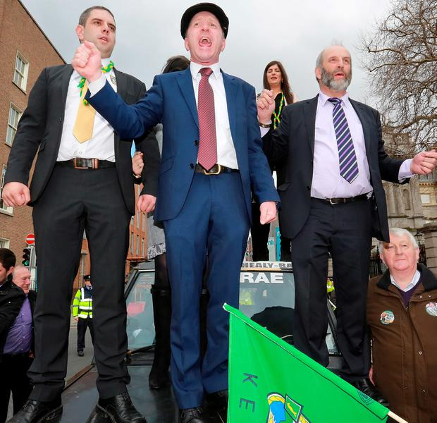 COUNTRY MATTERS: Michael Healy-Rae, centre, is one of several politicians calling for a full Cabinet portfolio to be created for rural affairs. Photo: Frank McGrath