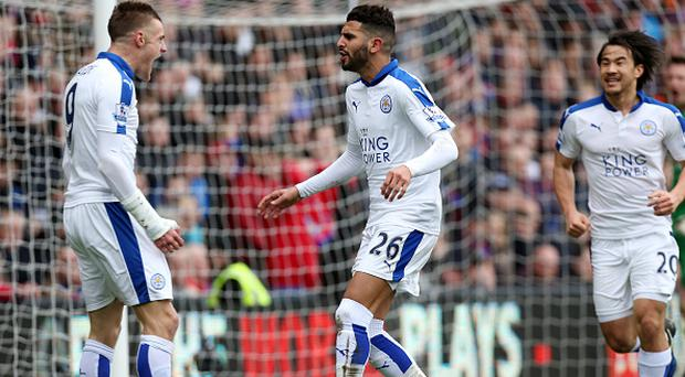 LONDON, ENGLAND - MARCH 19: Riyad Mahrez of Leicester City celebrates with Jamie Vardy of Leicester City after scoring to make it 0-1 during the Premier League match between Crystal Palace and Leicester City at Selhurst Park on March 19, 2016 in London, United Kingdom. (Photo by Plumb Images/Leicester City FC via Getty Images)