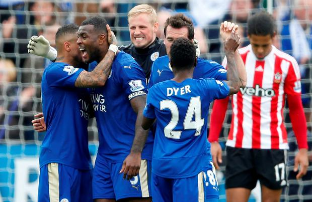 Leicester City's Danny Simpson, Wes Morgan, Kasper Schmeichel, Christian Fuchs and Nathan Dyer celebrate at full time