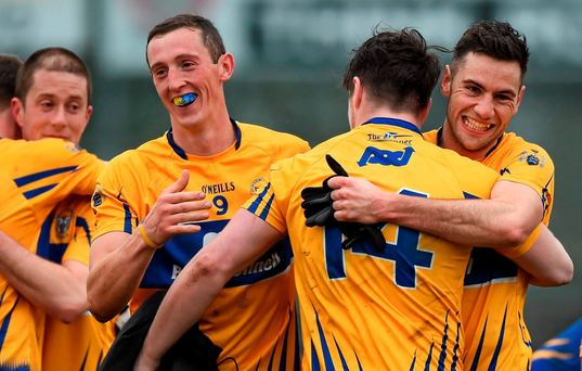 Clare players, from left, Cathal O'Connor, Keelan Sexton and Dean Ryan celebrate their promotion to Division 2