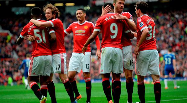 Manchester United's Timothy Fosu-Mensah, Daley Blind, Chris Smalling, Anthony Martial, Michael Carrick and Matteo Darmian celebrate
