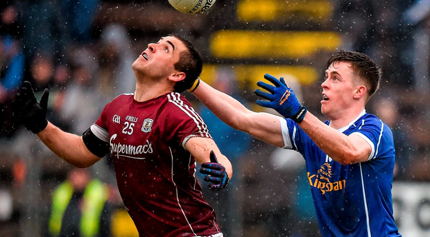 Patrick Sweeney of Galway only has eyes for the ball as he is challenged by Cavan's Dara McVeety Photo: Cody Glenn / SPORTSFILE