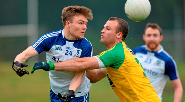 Conor McCarthy, Monaghan, in action against Neil McGee, Donegal. Photo: Sportsfile