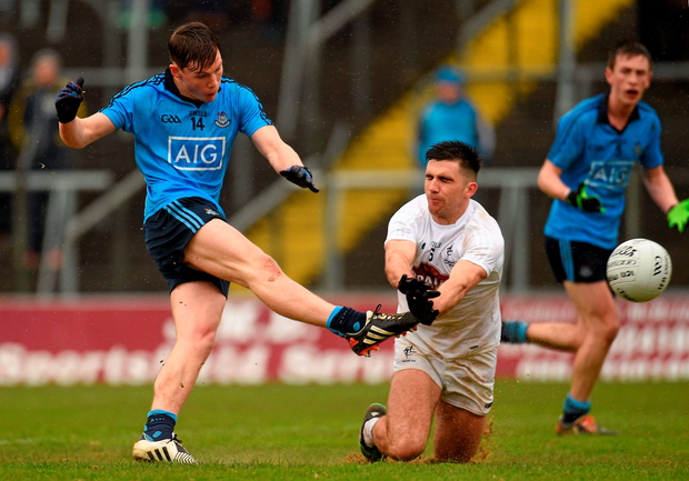 Man of the match Con O'Callaghan blasts home Dublin's opening goal despite the valiant efforts of Kildare wing-back Ryan Houlihan Picture credit: Paul Mohan / SPORTSFILE