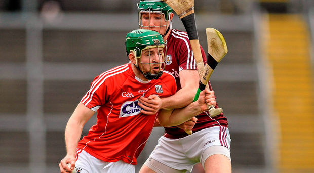 Cork defender Cormac Murphy tries to force his way past Galway forward Cathal Mannion during yesterday's Allianz NHL Division One relegation play-off at Pearse Stadium yesterday. Photo: Sportsfile