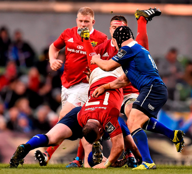 David Kilcoyne goes head-first after being tackled by Cian Healy (hidden) in the incident which led to the Leinster prop being shown the yellow card Photo: Ramsey Cardy / SPORTSFILE