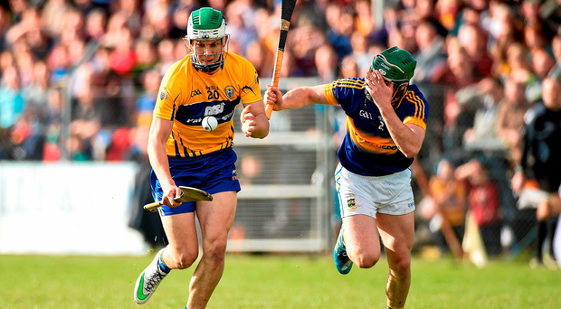 Aaron Shanagher, of Clare holds off Tipperary's Cathal Barrett on his way to scoring his side's second goal in Ennis. Photo: Sportsfile