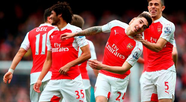 Hector Bellerin (2nd R) of Arsenal celebrates scoring his team's third goal with his team mates. Photo: Getty