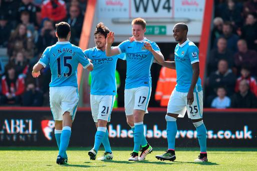 Kevin de Bruyne (2nd R) of Manchester City celebrates scoring his team's second goal with his team mates. Photo: Getty
